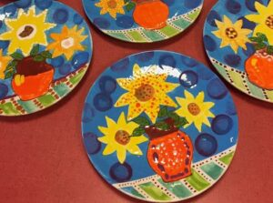 Plates made in pottery class at kids party