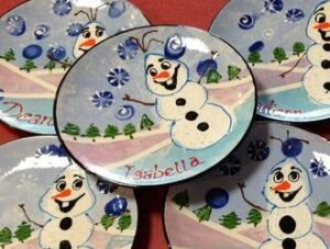 Ceramic snowman plate painted by children