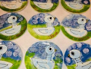 Ceramic plates with hand painted ducks